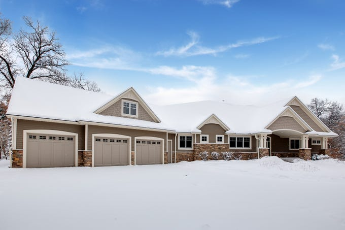 This custom craftsman-style home sits on nearly 17 acres of land and just aside a small, private wildlife lake.