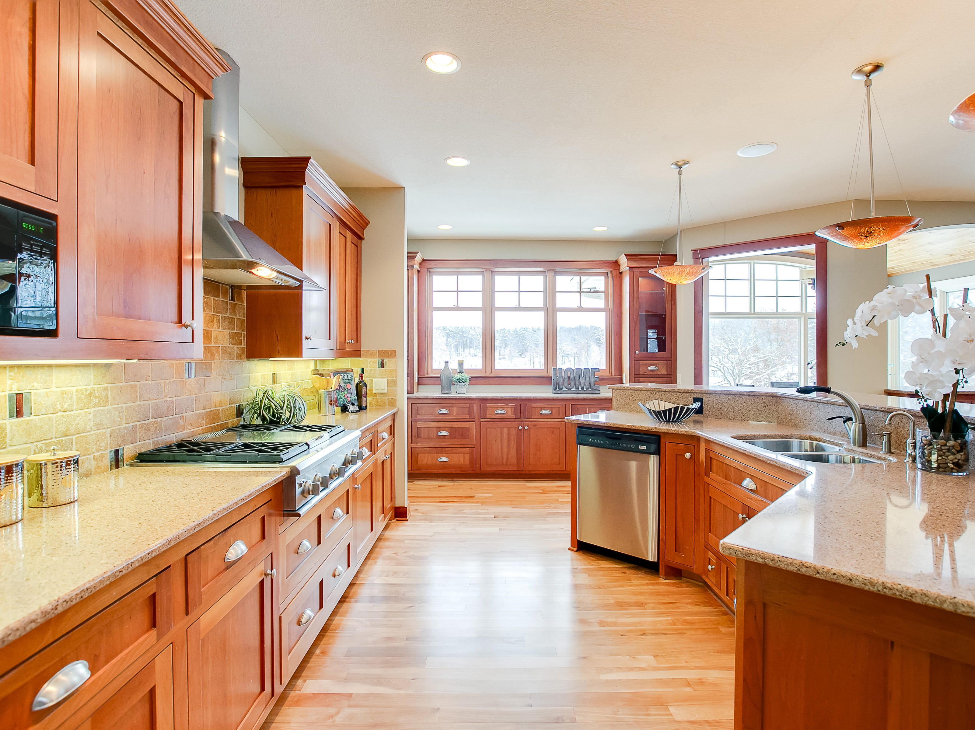 The kitchen features cherry cabinets, birch hardwood floors and Cambria countertops.