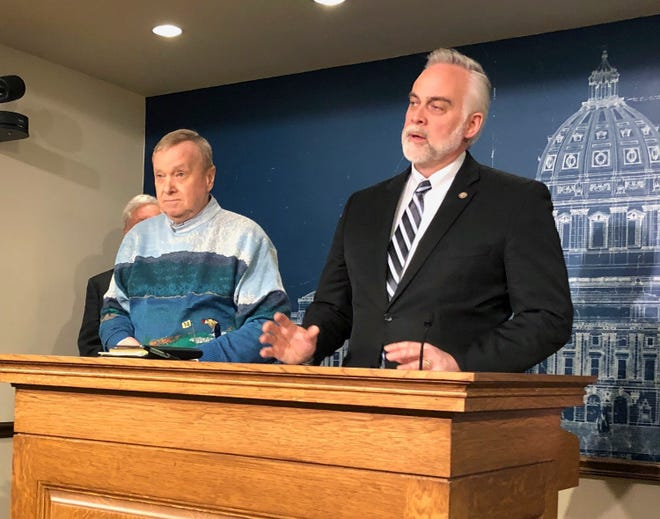 Minnesota State Reps. Gene Pelowski, D-Winona, left, and Tony Albright, R-Prior Lake, discuss legislation to replenish a disaster aid fund ahead of anticipated spring flooding during a news conference at the state Capitol in St. Paul, Minn., Monday, March 11, 2019.