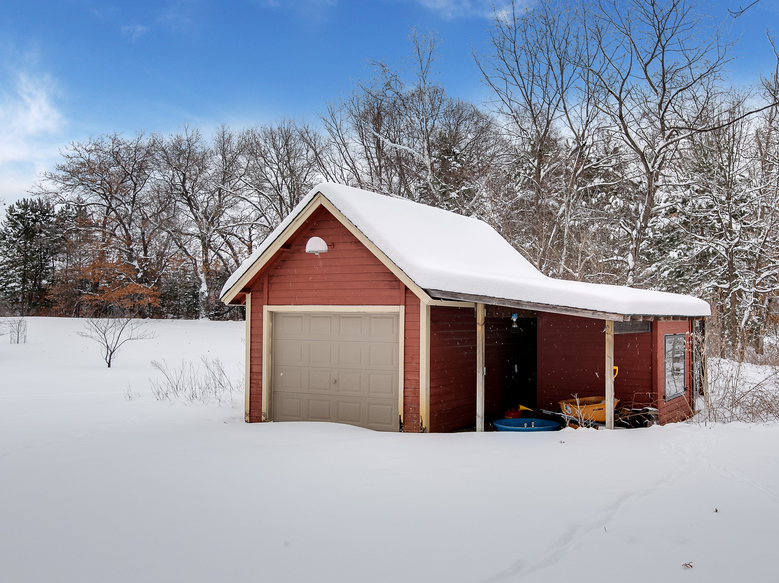 The property beyond the home offers a large garden shed with an attached chicken coop.