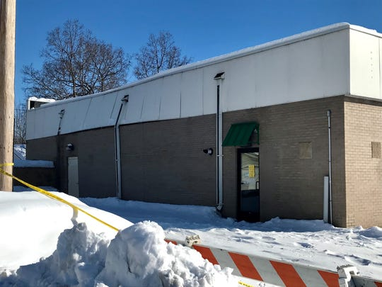 The University Crossing building at University Drive and Ninth Avenue South is closed following a weekend roof collapse. The east and west walls of the building were visibly buckling on Monday, March 11.
