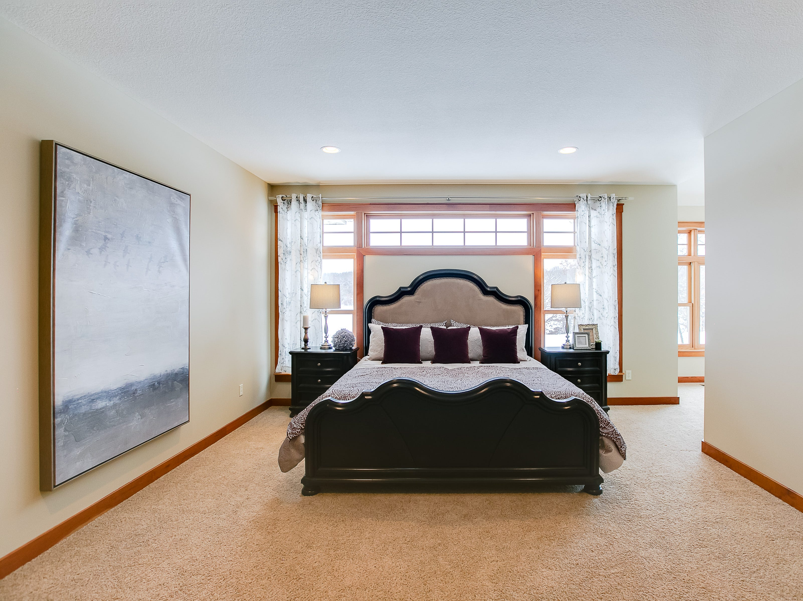 The master bedroom for this home sits on the main floor and has a sitting room of its own.