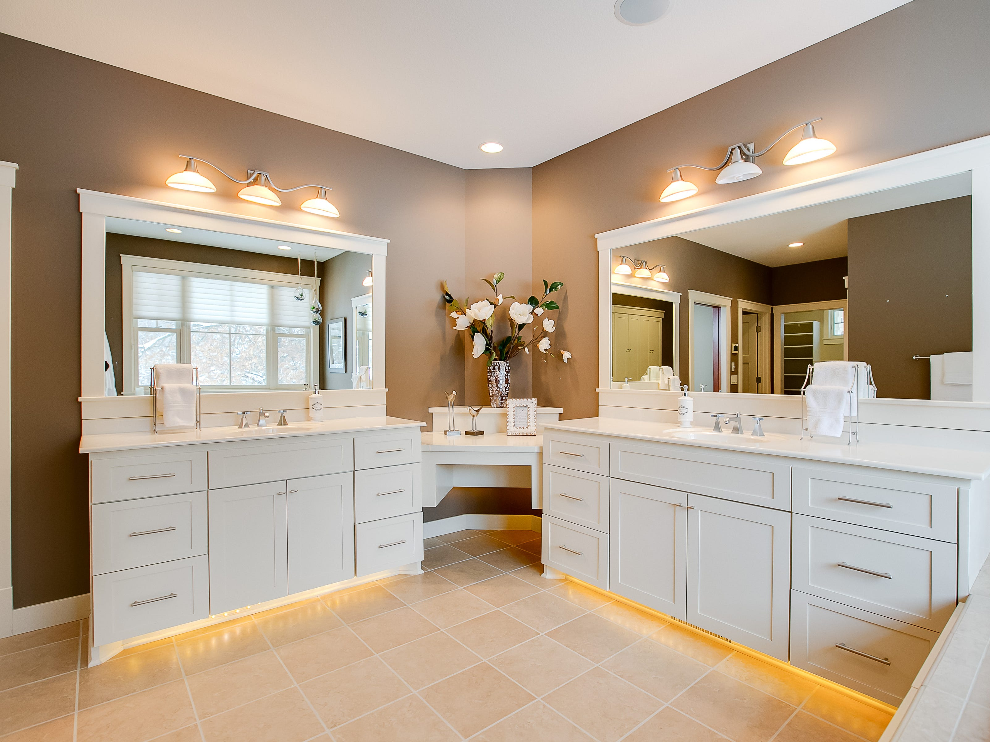 The master features its own en suite with a soaking tub, double vanities and a walk-in shower.