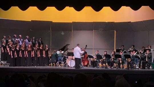 Snow Canyon High School Music Director Terry Moore, directs the SCHS Madrigals and Jazz Band at a benefit concert on Dec 6, 2018.