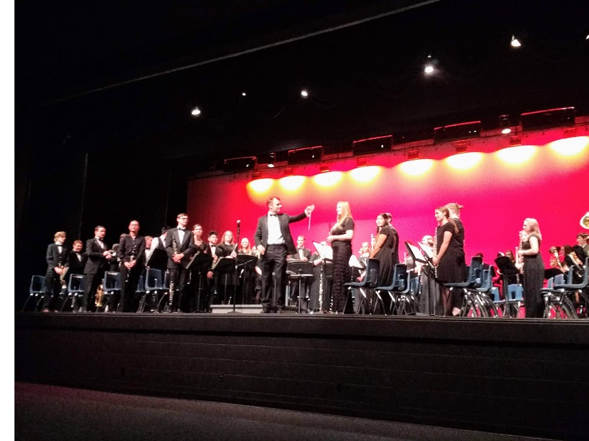 Dr Bryant Smith conducts both the Dixie State University Symphony Band and Snow Canyon High Band as they perform together on Nov 27, 2018.
