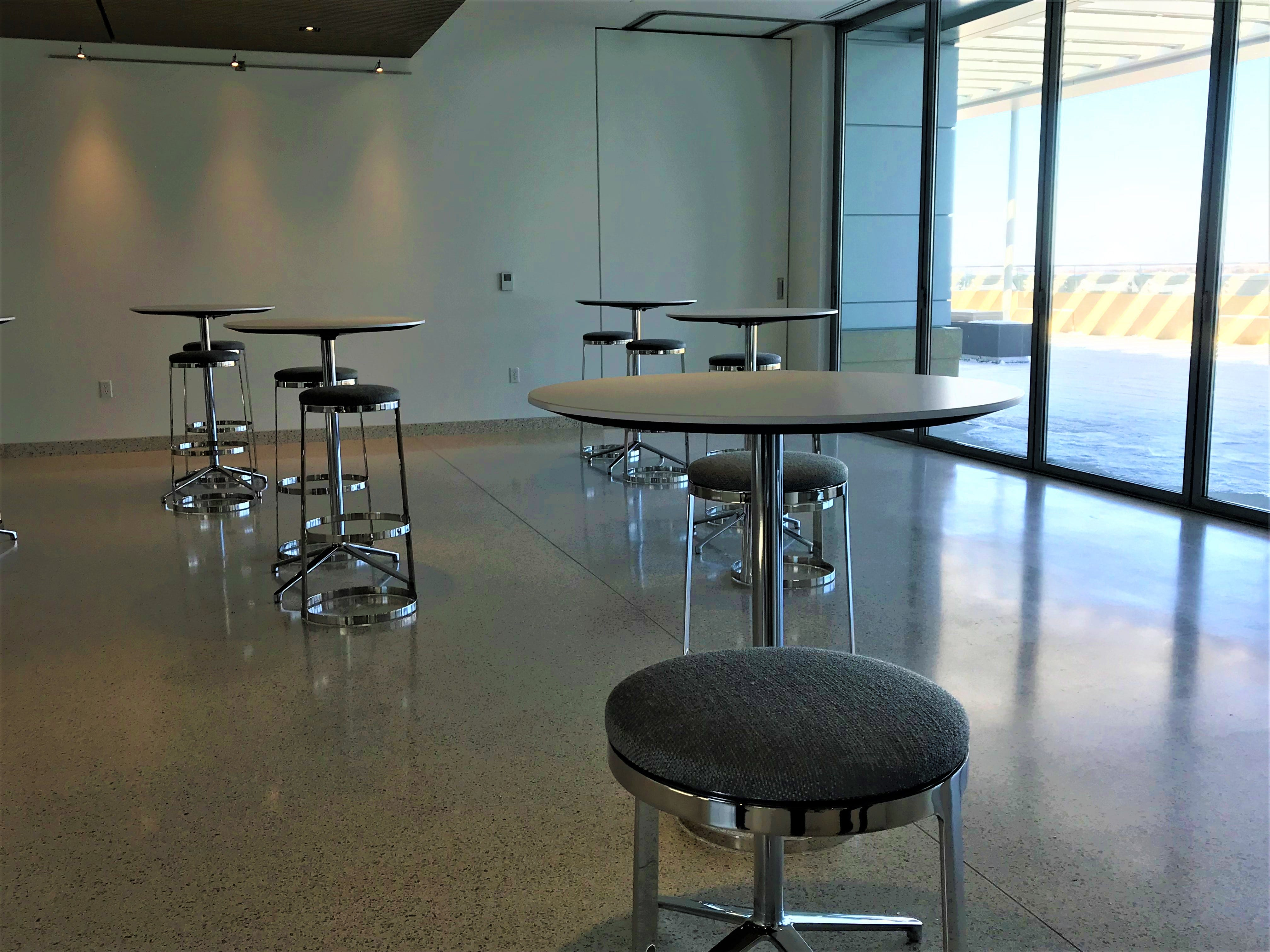 Tables are set up in a multi-purpose room in the new Sentry building. The glass can be removed for large gatherings to include a patio space.
