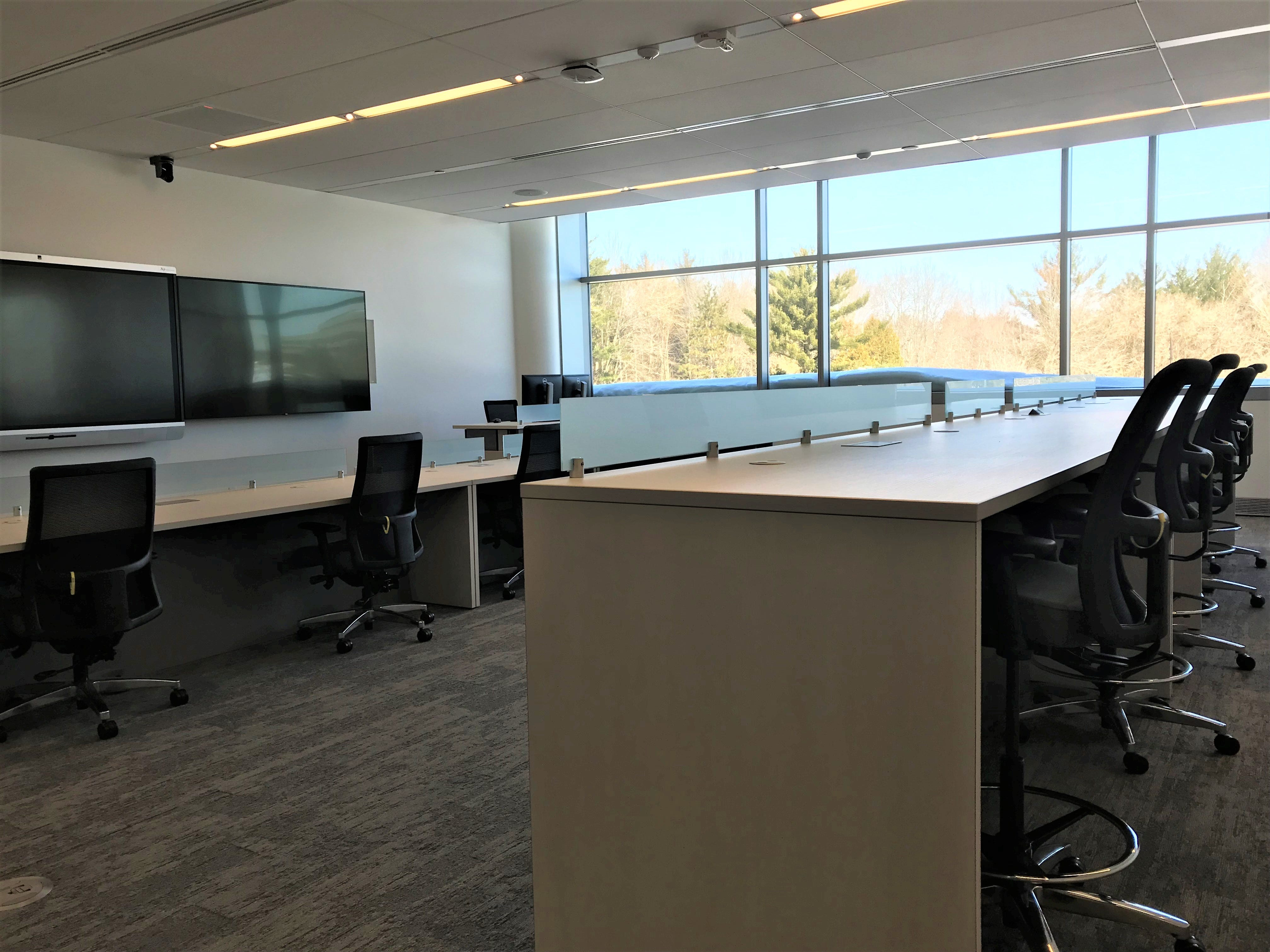 Employees can use rooms set up for presentations in the new Sentry building.
