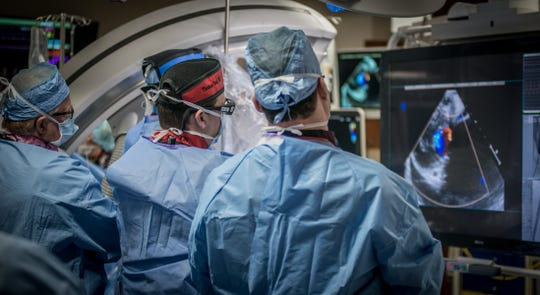 TMH cardiologists perform a procedure in the cath lab.