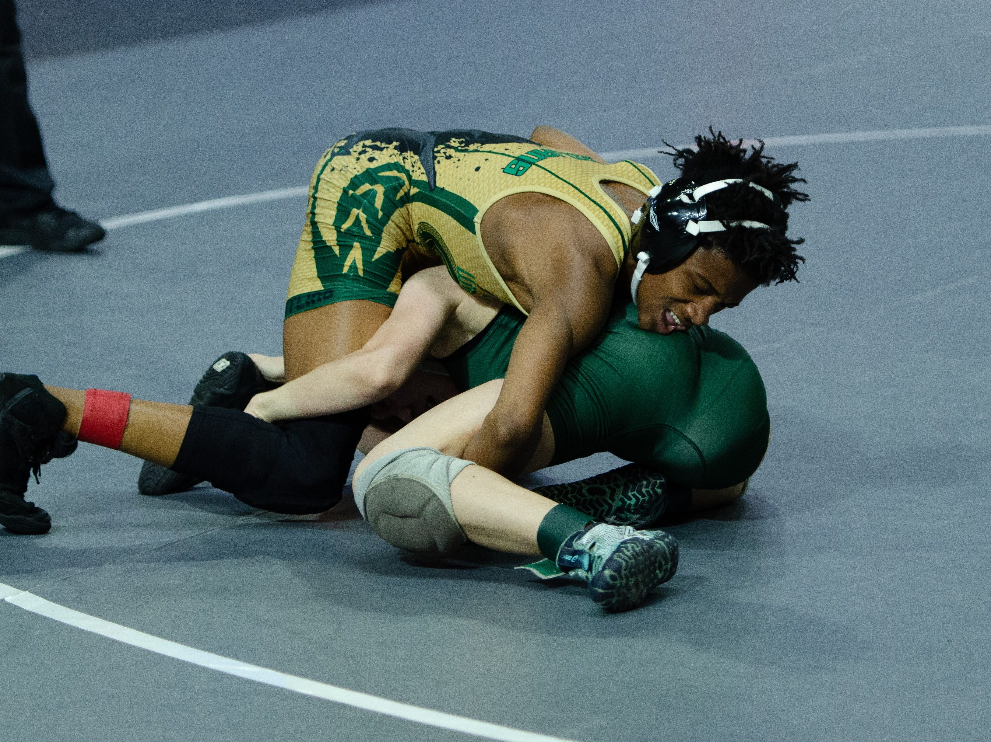 Lincoln's Elijah Hendley wrestles at the FHSAA Wrestling State Championships inside Silver Spur Arena in Kissimmee.