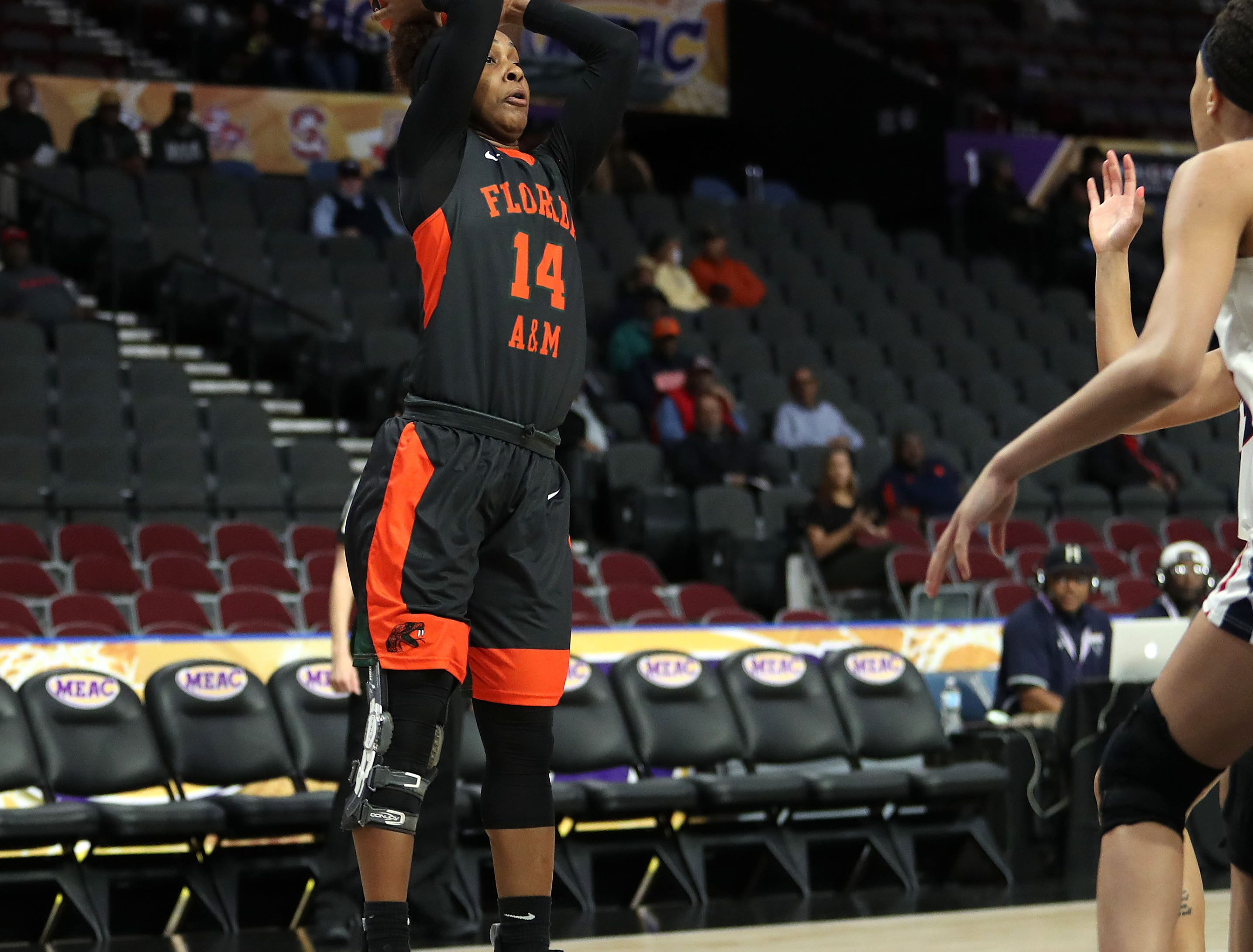 FAMU's Tyra James looks to pass the ball against Howard in the first round of the MEAC tournament on Monday, March 11, 2019.