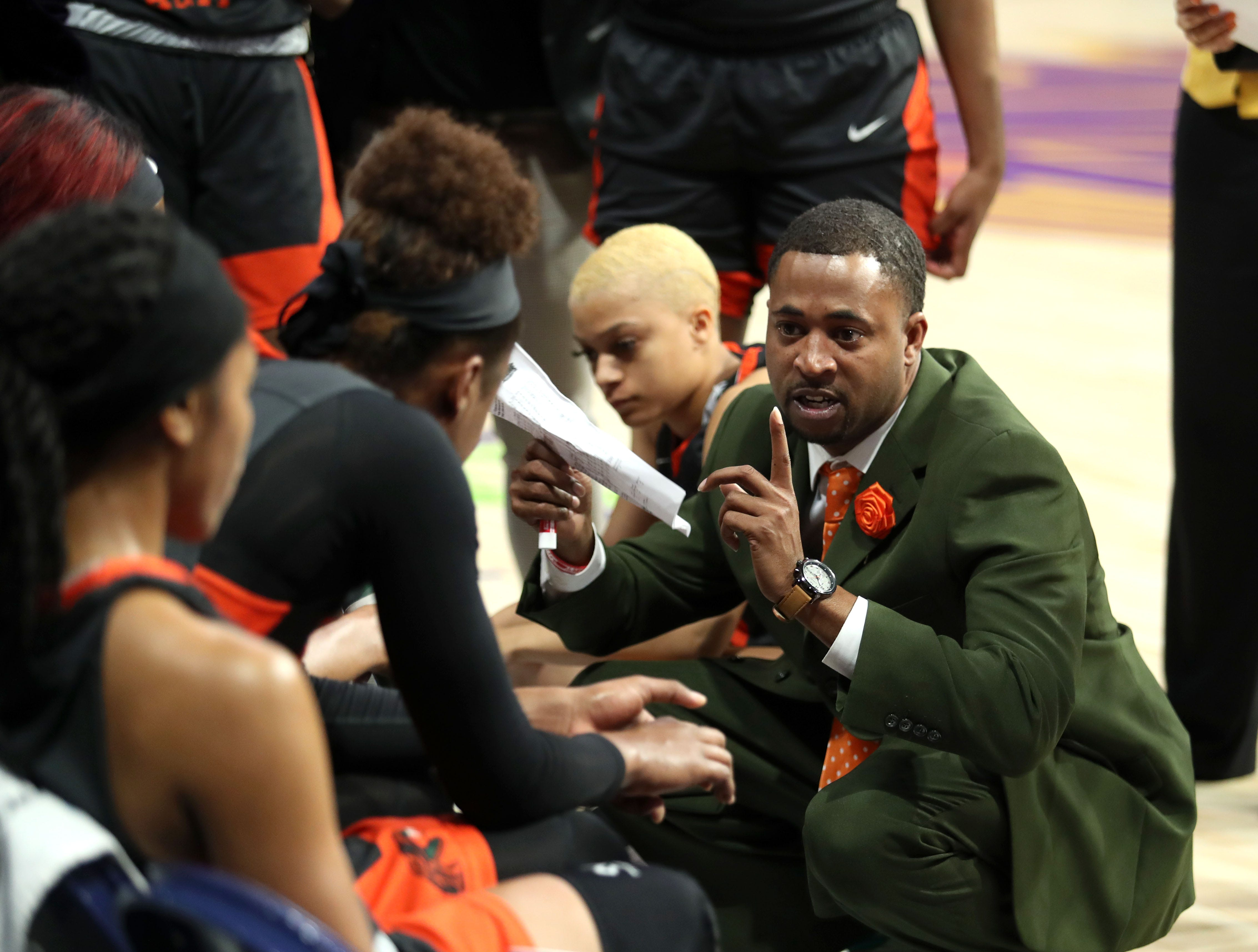 FAMU women's interim head coach Kevin Lynum goes over plays during a timeout versus Howard at the MEAC tournament on Monday, March 11, 2019.