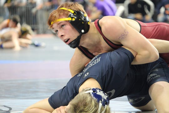 Florida High's Tyler Reeve wrestles at the FHSAA Wrestling State Championships inside Silver Spur Arena in Kissimmee.