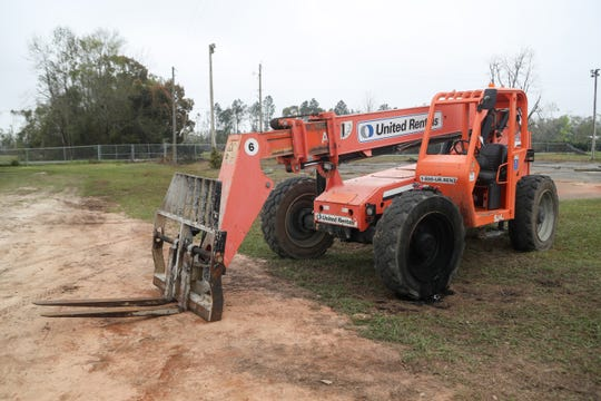 The boom truck Corey Crum was operating when he and his wife were electrocuted and died sits outside the Liberty County High School baseball field Monday morning, less than 24 hours after the accident occurred on Sunday, March 10, 2019.