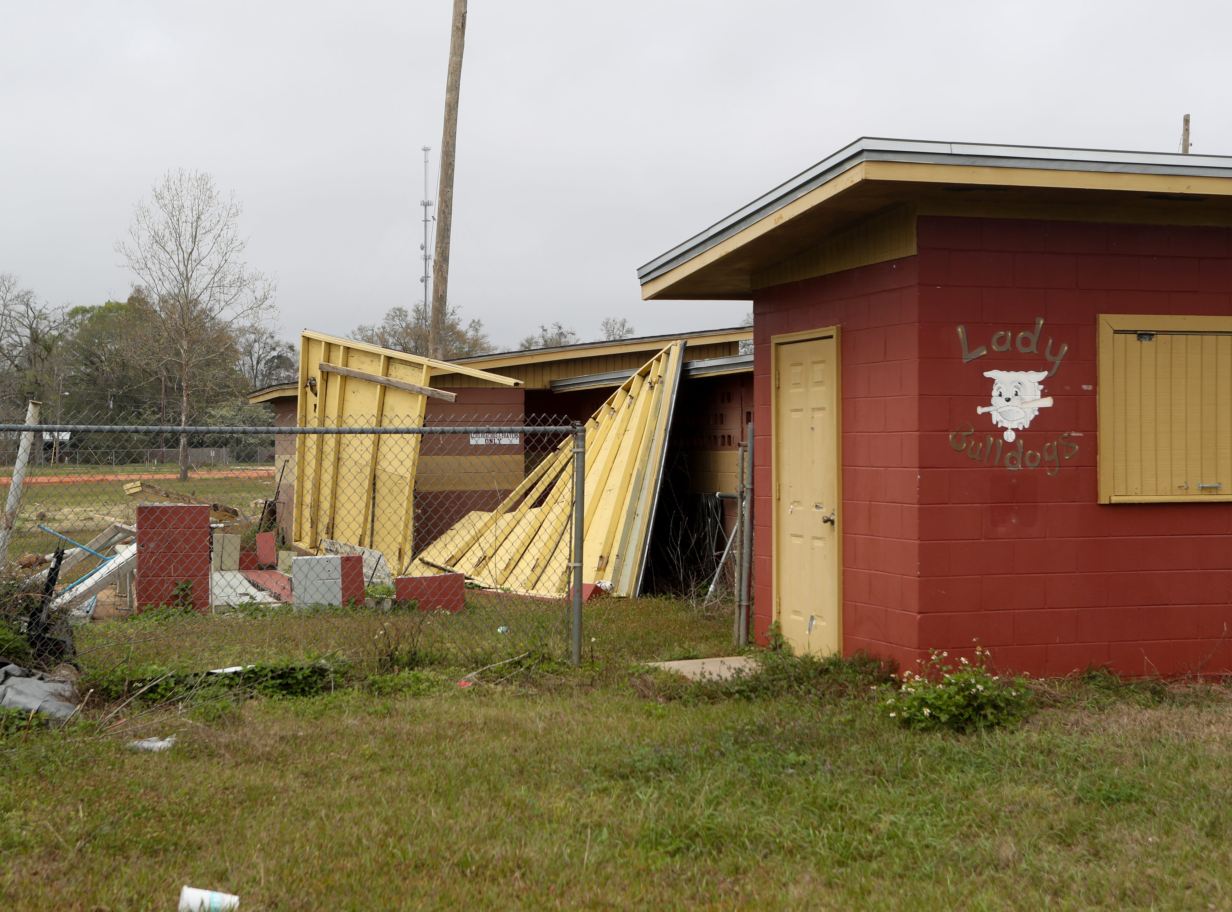 The Liberty County High School athletic field complex was heavily damaged by Hurricane Michael in October. Head Baseball Coach Corey Crum and his wife Shana Crum were killed Sunday while working at the field to repair damages.