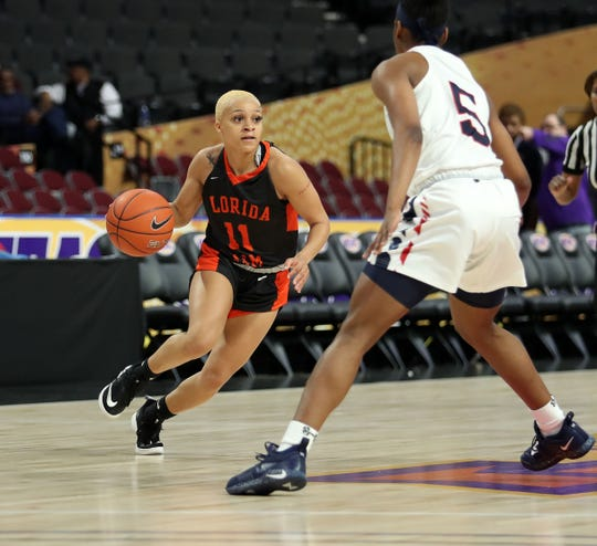 FAMU point guard Morgan Mitchell looks to dribble by Howard's Sarah Edmond in the first round of the MEAC tournament on Monday, March 11, 2019.