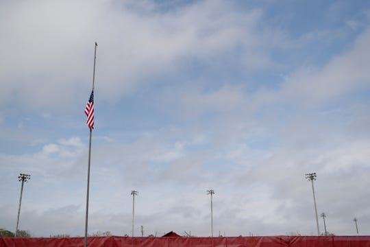 The American flag flies at half staff over the Liberty County High School baseball field Monday morning, less than 24 hours after Corey Crum, head baseball coach and his wife Shana Crum, died at the field after being electrocuted. Their son was also electrocuted but survived.