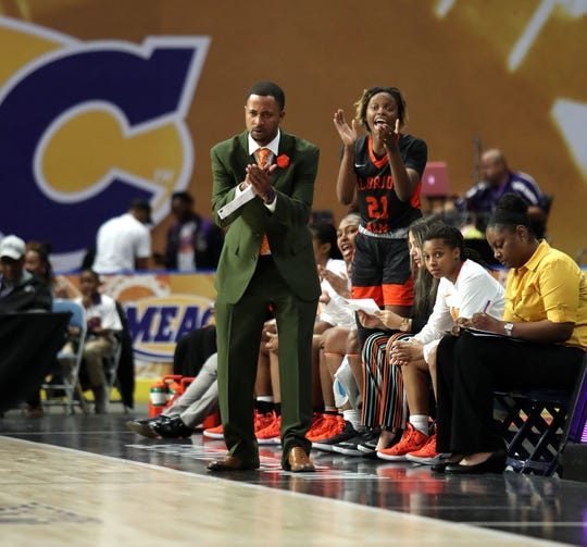 FAMU women's basketball interim head coach Kevin Lynum cheers on the team's effort versus Howard in the first round of the MEAC tournament on Monday, March 11, 2019.