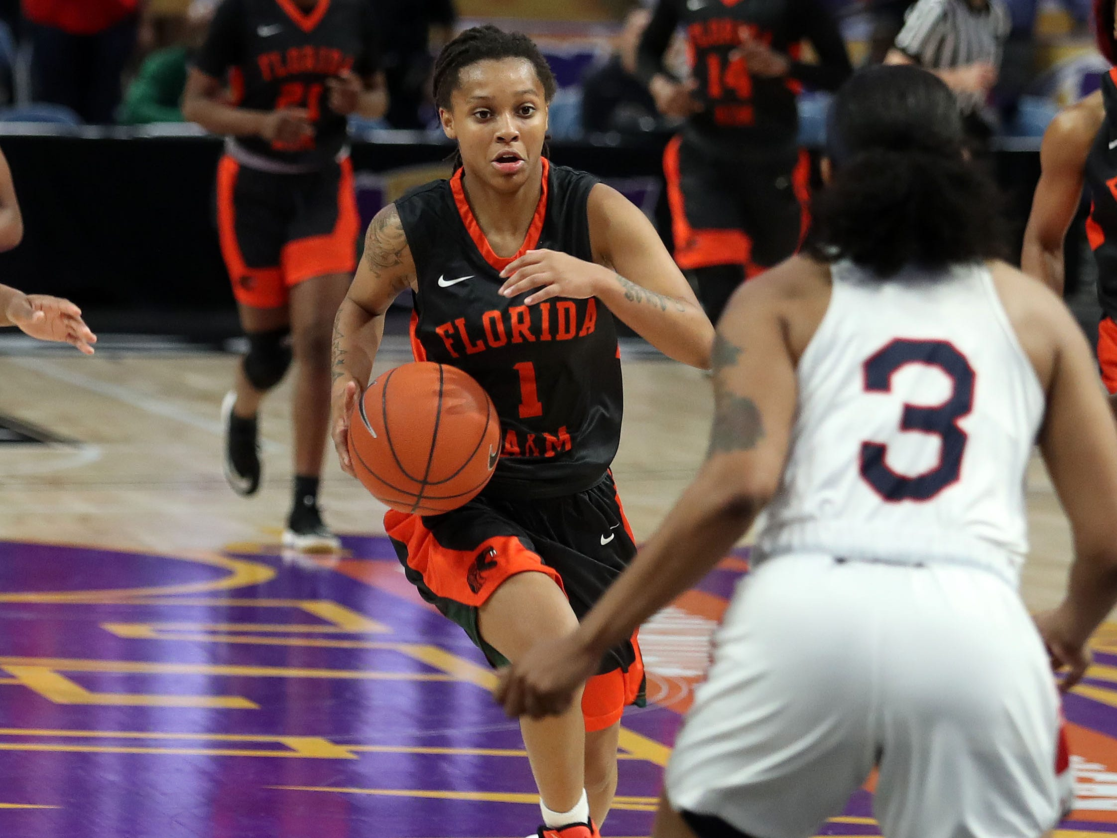 MEAC All-Rookie guard Mya Moye dribbles the ball against Asia McCants (3) during FAMU's first-round MEAC tournament game versus Howard.
