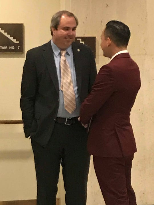 Sen. Joe Gruters, R_Sarasota, chats with Rep. Carlos Guillermo Smith, D-Orlando Monday before a Democratic news conference critical of Gruters' sanctuary cities bill.
