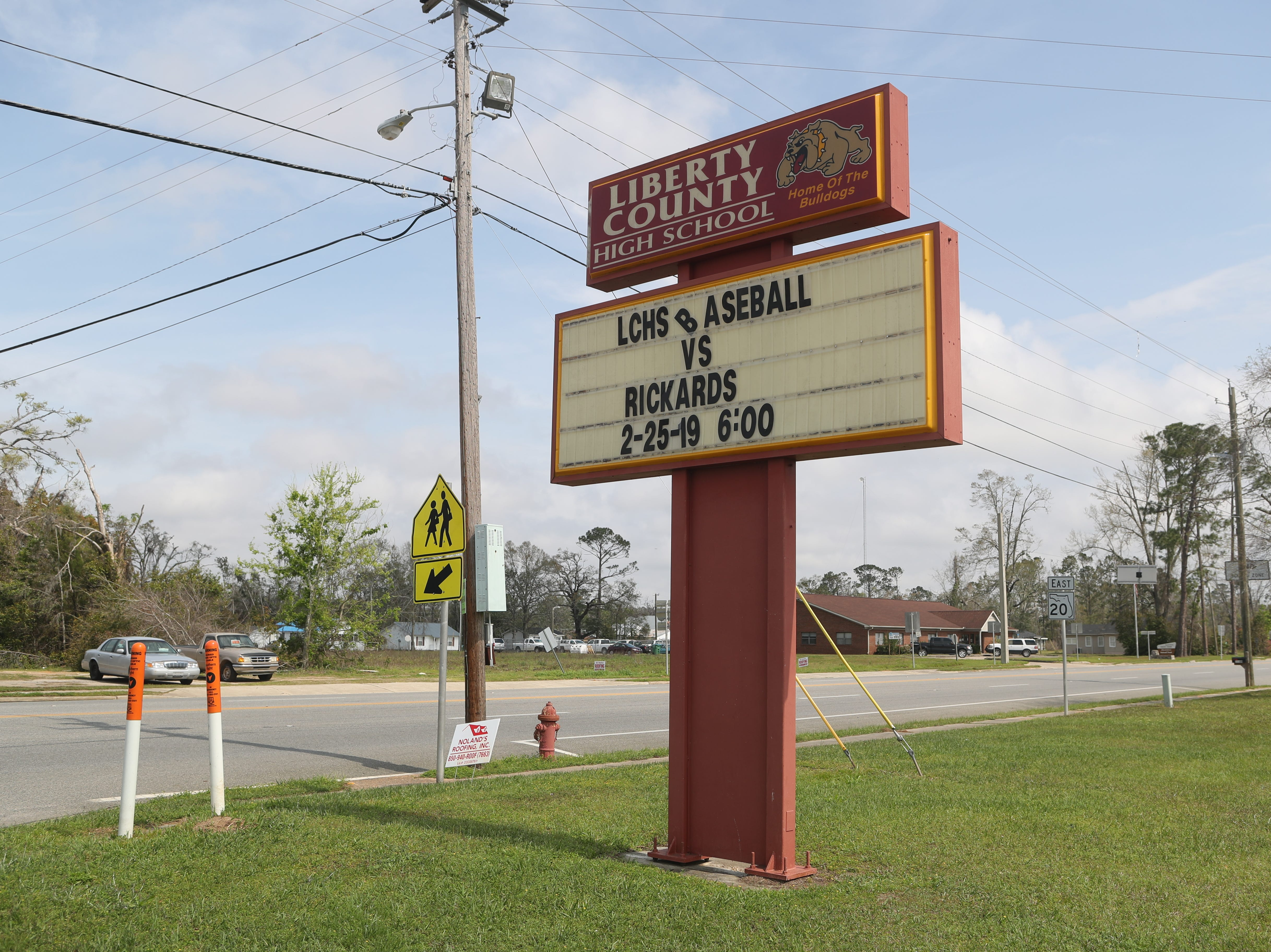 The Liberty County High School sign publicizes a past baseball game versus Rickards Monday morning, less than 24 hours after Corey Crum, head baseball coach, and his wife Shana died at the Liberty County baseball field after being electrocuted Sunday, March 10, 2019.