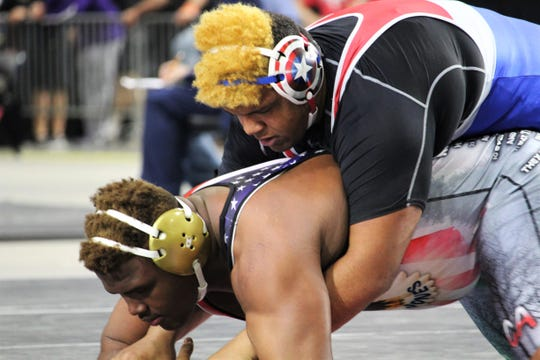 Wakulla's Darius Wilkins wrestles at the FHSAA Wrestling State Championships inside Silver Spur Arena in Kissimmee.
