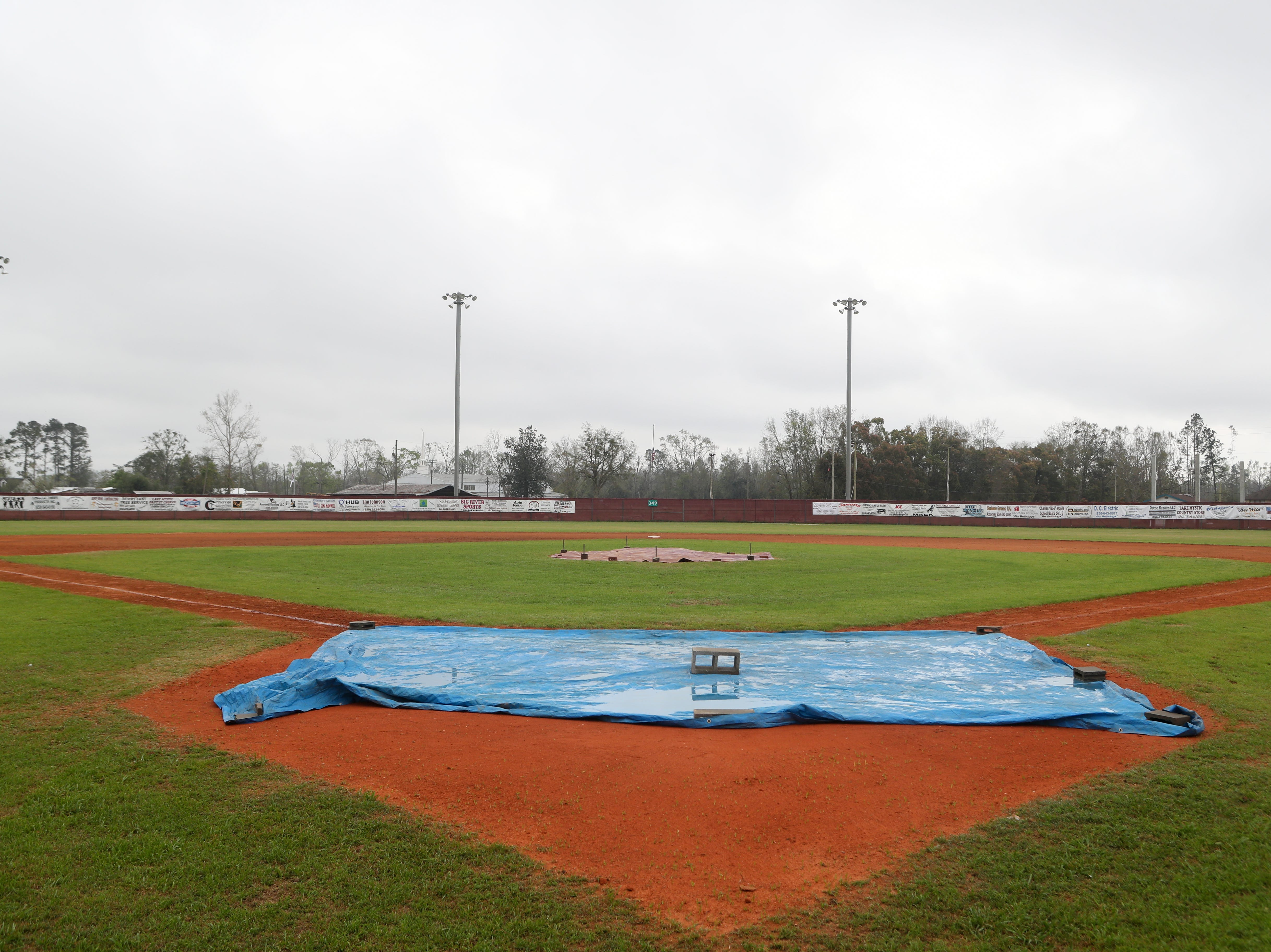 Clouds and fog loom over the Liberty County High School baseball field Monday afternoon, just 24 hours after Corey Crum, head baseball coach and his wife Shana Crum, died after being electrocuted while working at the field Sunday, March 10, 2019.