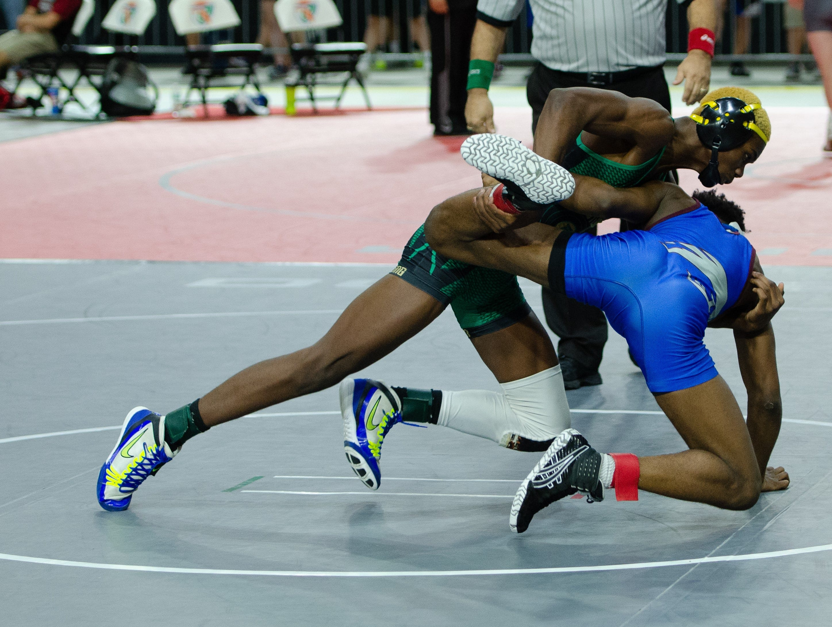 Lincoln's Ikeon Myles wrestles at the FHSAA Wrestling State Championships inside Silver Spur Arena in Kissimmee.