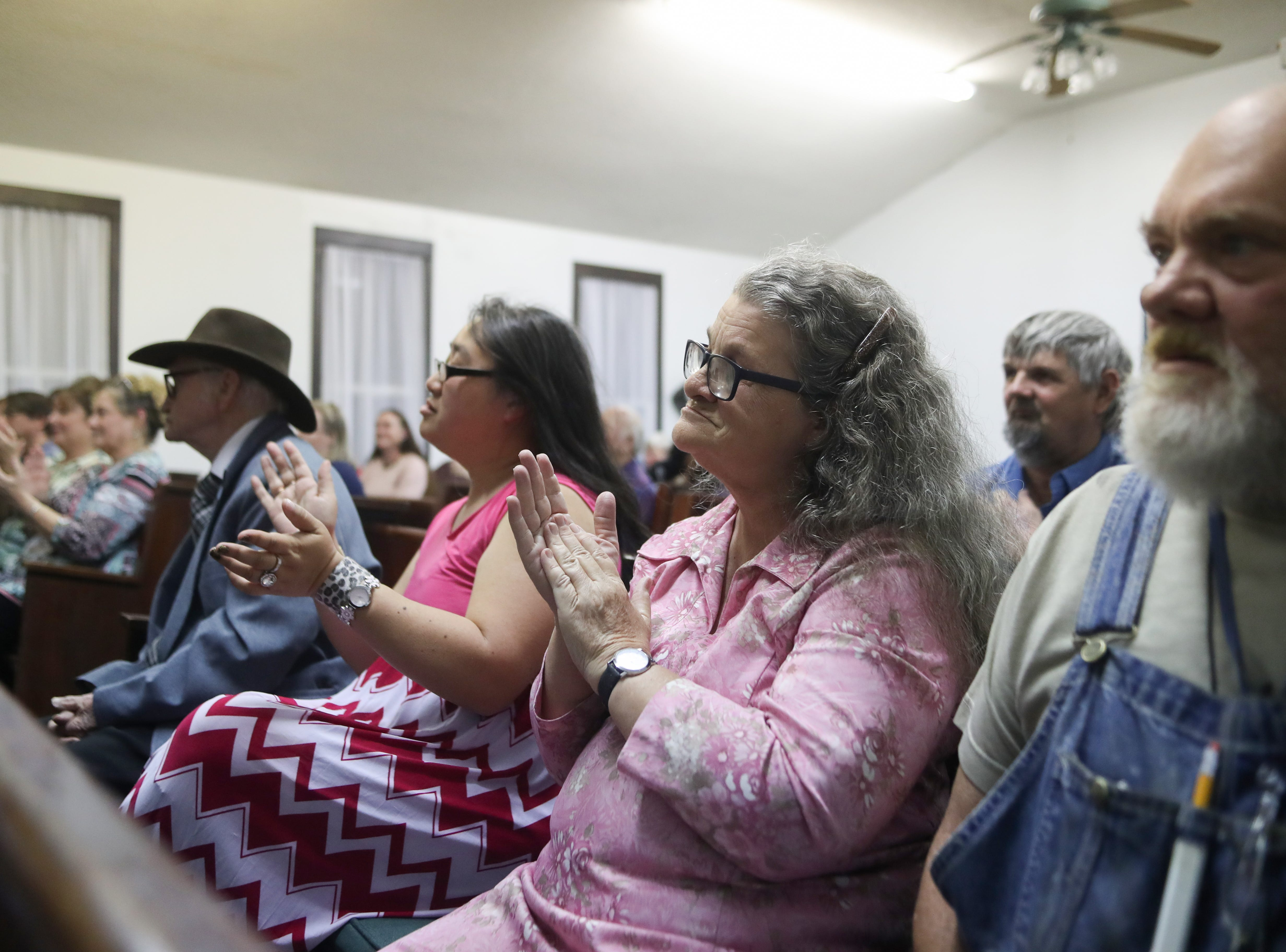 Members of the Ole Gospel Tabernacle Church clap along to the music during the last gospel sing service at Ole Gospel Tabernacle Church Friday, March 8, 2019.