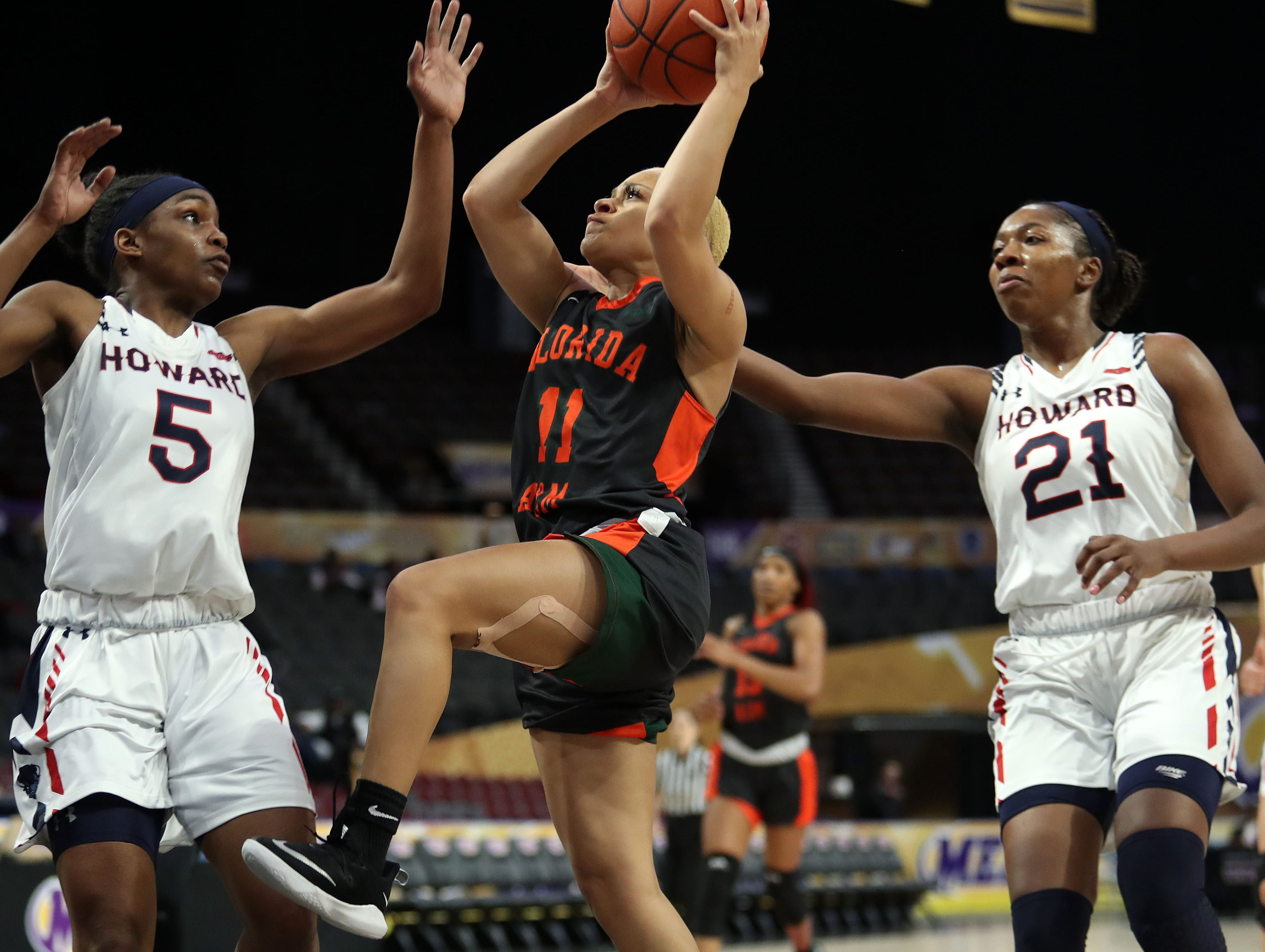 FAMU guard Morgan Mitchell looks to score over Sarah Edmond (5) and Star Fitzgerald-Greer (21) in the first round of the MEAC tournament on Monday, March 11, 2019.