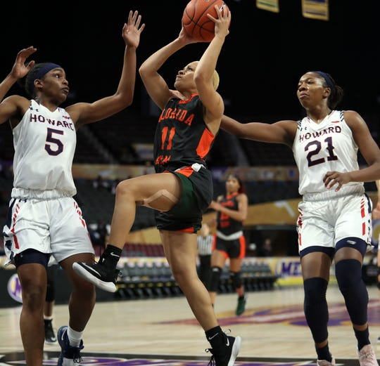 FAMU guard Morgan Mitchell looks to score over Howard players Sarah Edmond (5) and Star Fitzgerald-Greer (21) in the first round of the MEAC tournament on Monday, March 11, 2019.