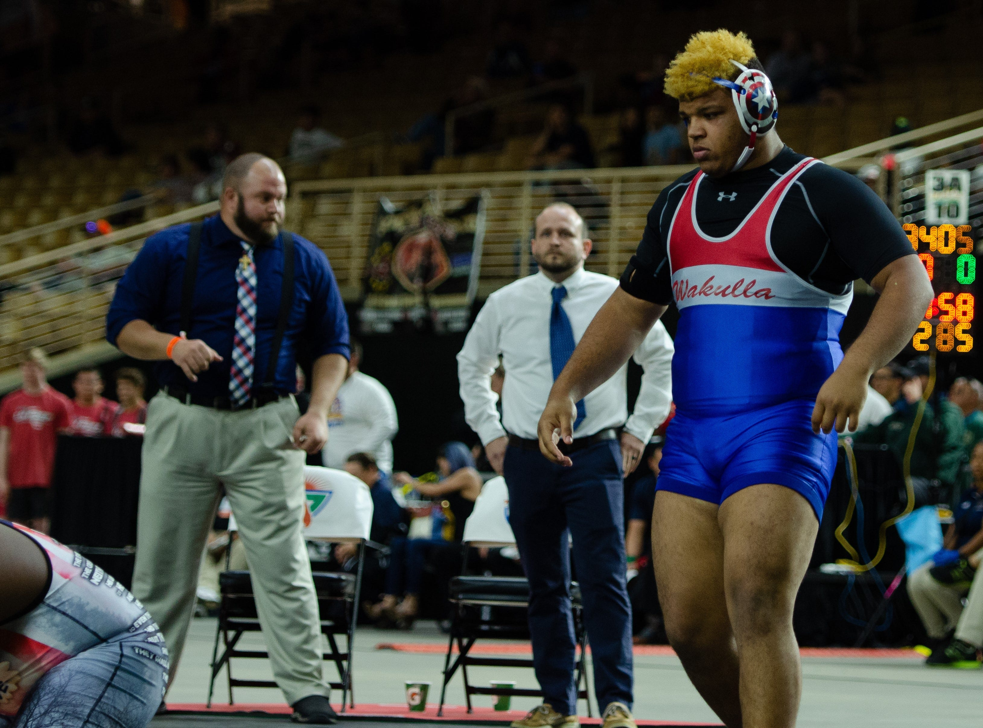 Wakulla's Darius Wilkins wrestles a heavyweight championship match at the FHSAA Wrestling State Championships inside Silver Spur Arena in Kissimmee.