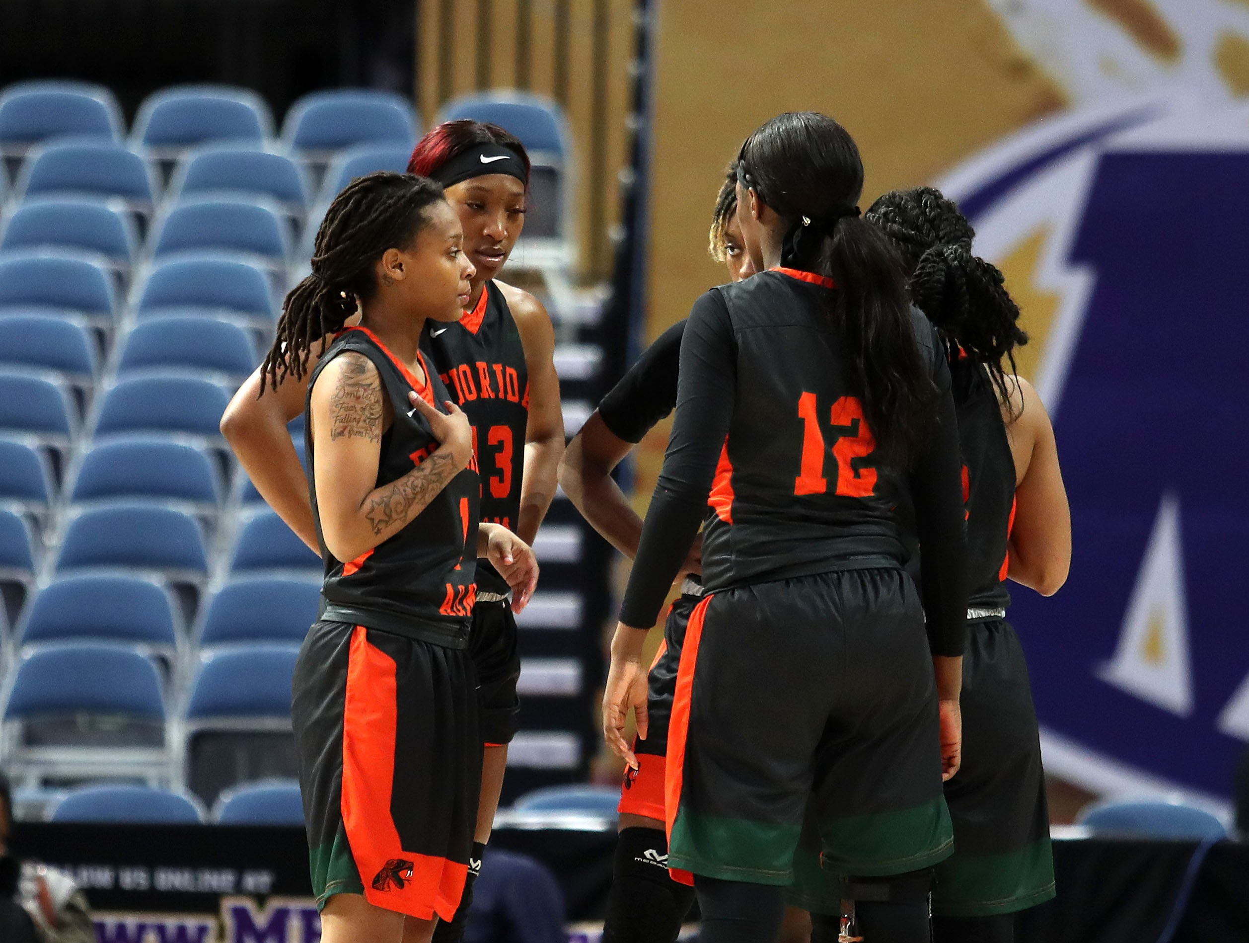 FAMU players huddle up on the court during the first round of the MEAC tournament versus Howard on Monday, March 11, 2019.