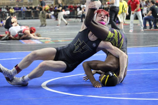 Florida High's Brooks Dyer wrestles at the FHSAA Wrestling State Championships inside Silver Spur Arena in Kissimmee.