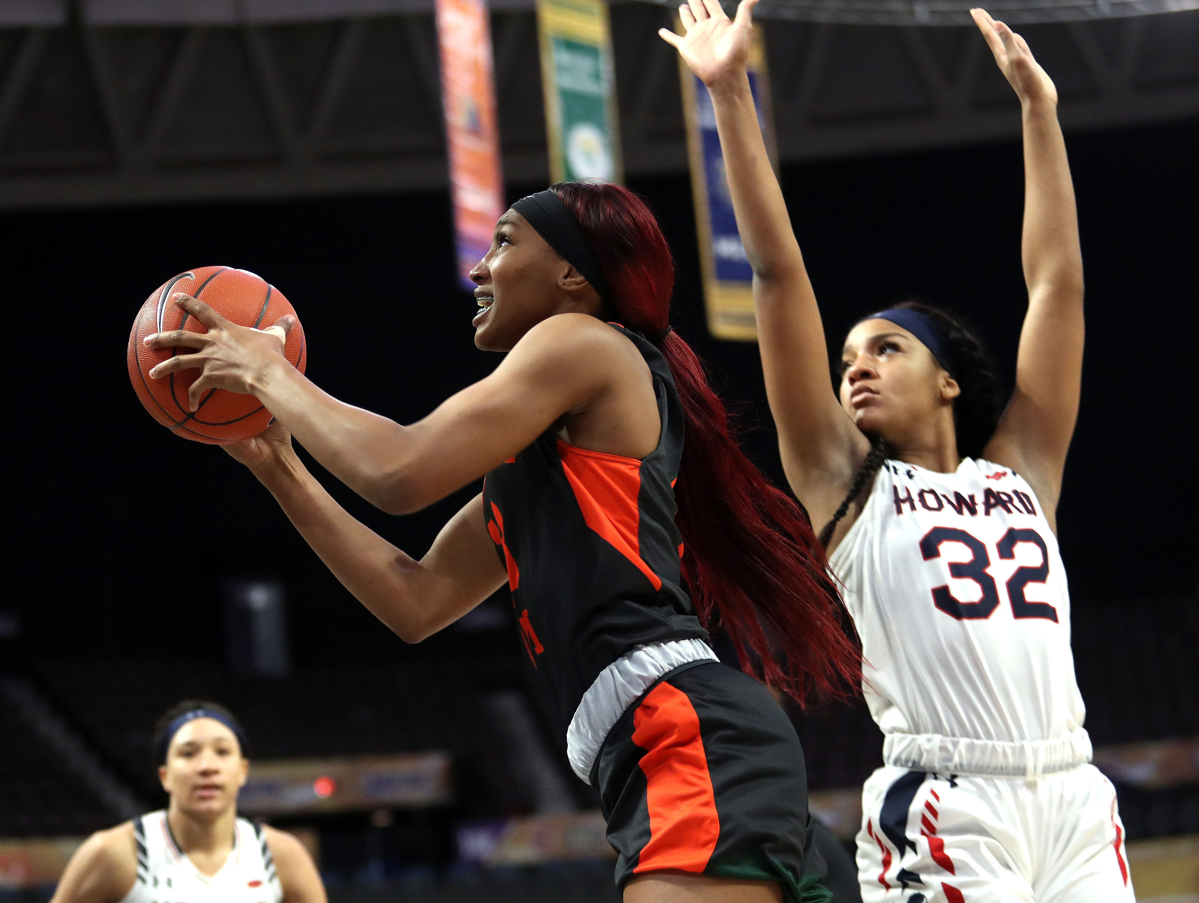 FAMU junior forward Dy'Manee Royal pulls up for a jumper over Krislyn Marsh (32) in the first round of the MEAC tournament on Monday, March 11, 2019.