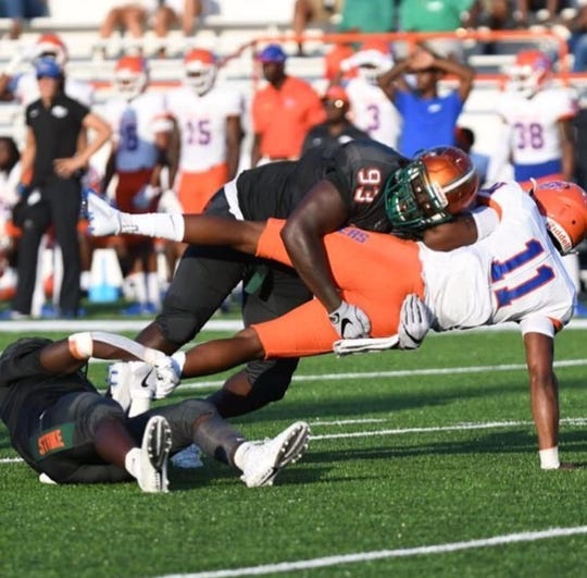 FAMU defensive lineman De'Montre Moore sacks Savannah State quarterback T.J. Bell at Bragg Memorial Stadium.