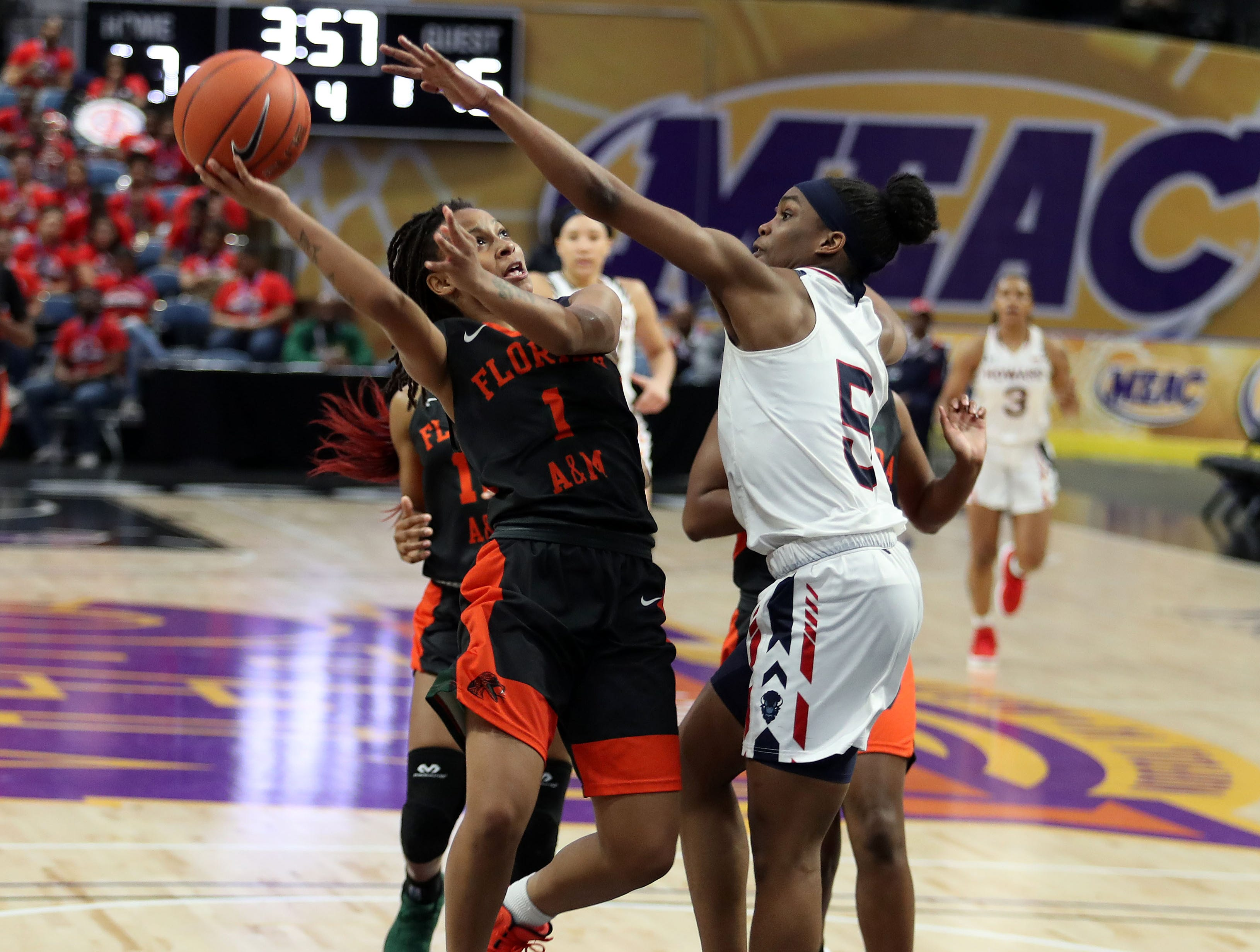 FAMU freshman Mya Moye shoots over Sarah Edmond of Howard in the first round of the MEAC tournament on Monday, March 11, 2019.