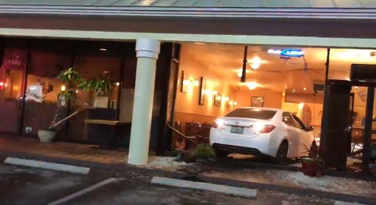 A car crashed through the front of El Cubanito restaurant in Port St. Lucie late Sunday.