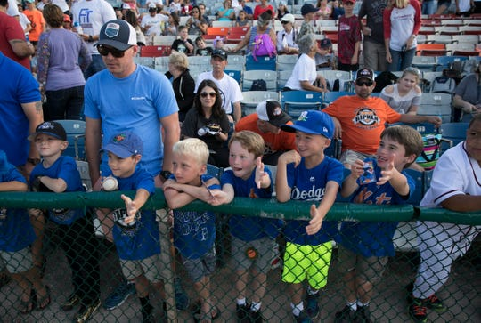 Little Dodgers fans wait patiently for the team to enter the field at the 2017 Jackie Robinson Celebration Game at Holman Stadium at Historic Dodgertown.
