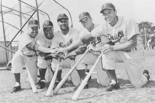 Duke Snider, left, Jackie Robinson, Roy Campanella, Pee Wee Reese and Gil Hodges at Dodgertown in Vero Beach, circa 1955, preparing for the season. All five stars made an indelible mark in Dodger history.