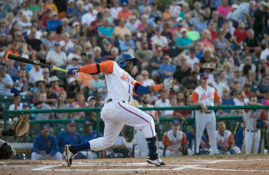 St. Lucie Mets' Champ Stuart takes a swing at the plate during the 2017 Jackie Robinson Celebration Game at Historic Dodgertown.