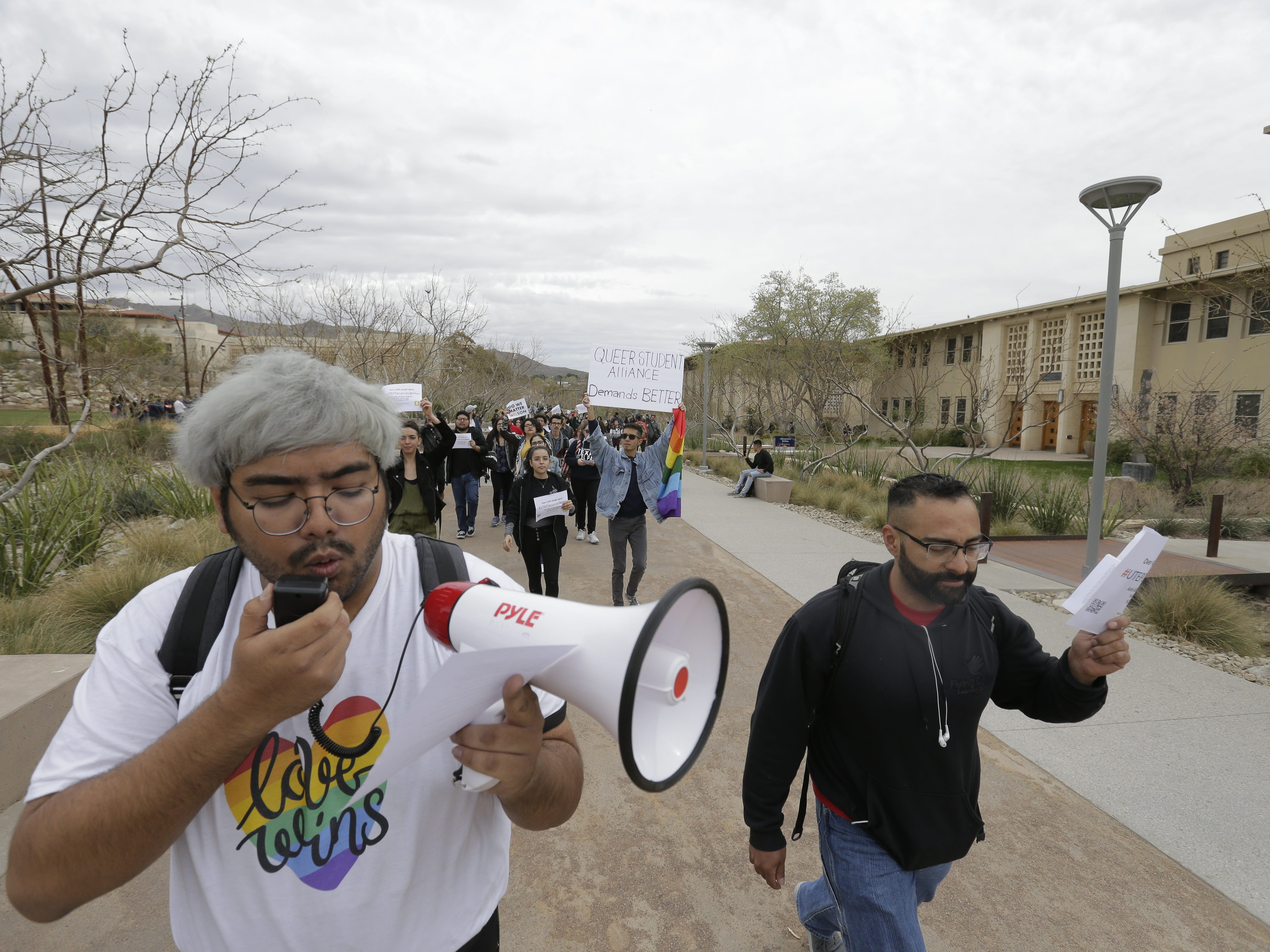 Michael Gutierrez, a computer science major, and other UTEP students on March 11 protest the appointment of Heather Wilson as the next president of the university.