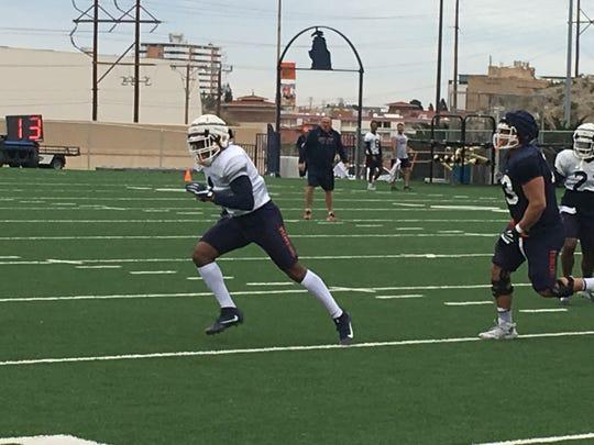 UTEP junior transfer linebacker Joe Jay Smith chases the ball at Monday's spring practice