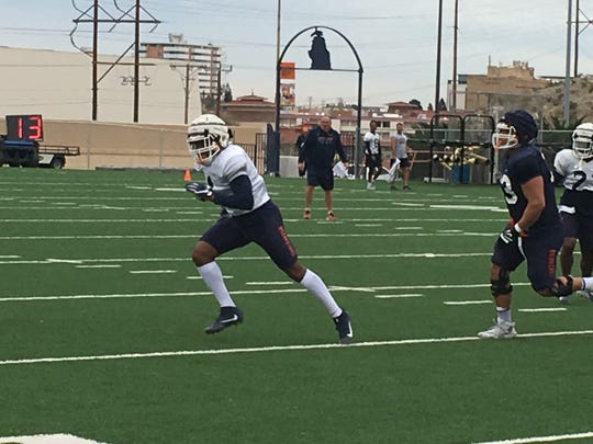UTEP junior transfer linebacker Joe Jay Smith chases the ball at Monday's spring practice