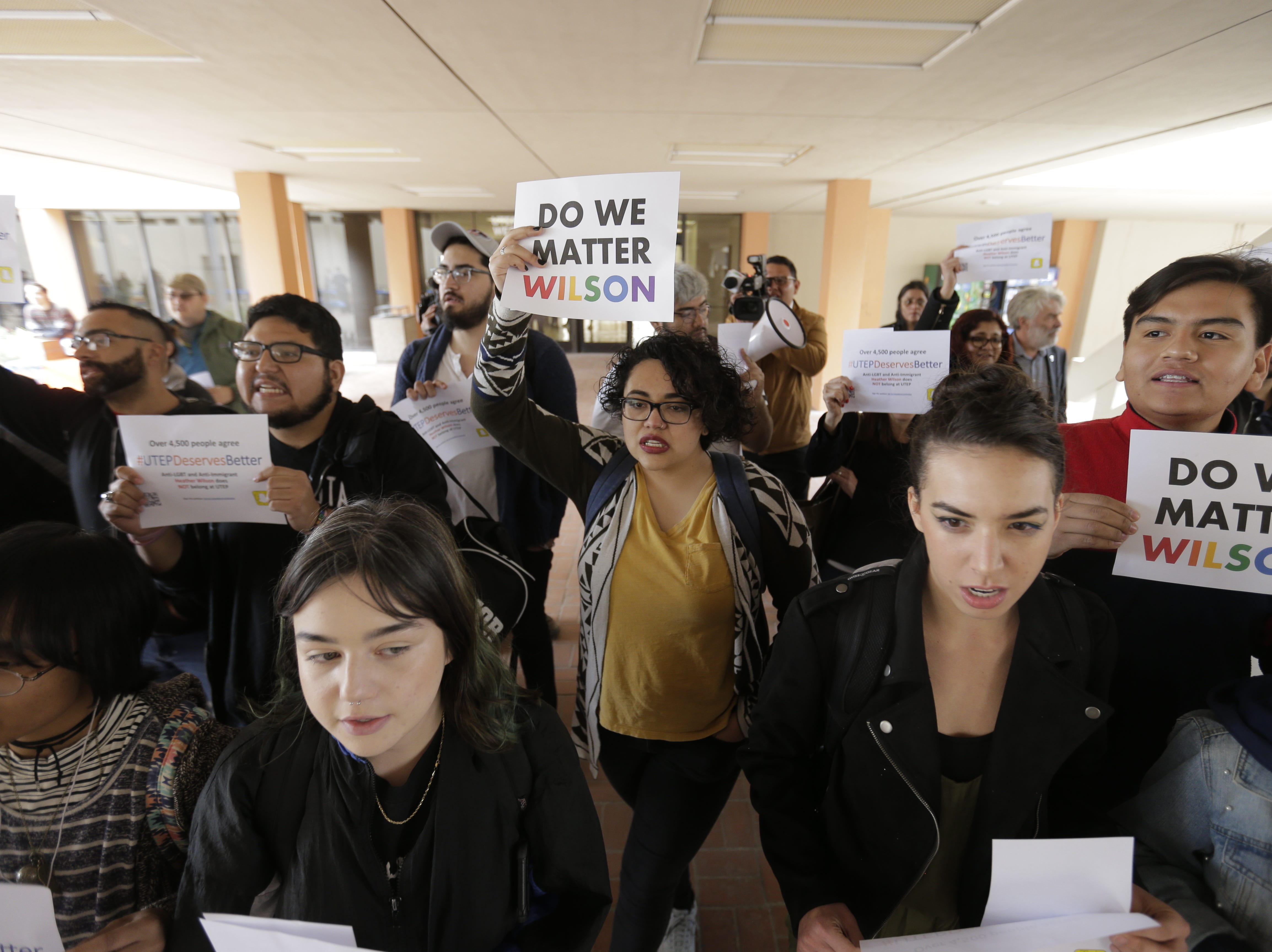 Center: Daisy Marquez and UTEP students protest the appointment of Heather Wilson as the next president of the university.