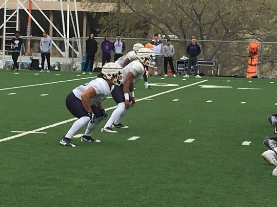 UTEP linebackers Sione Tupou, left, and Jayson Van Hook get ready for a snap at Monday's spring football practice