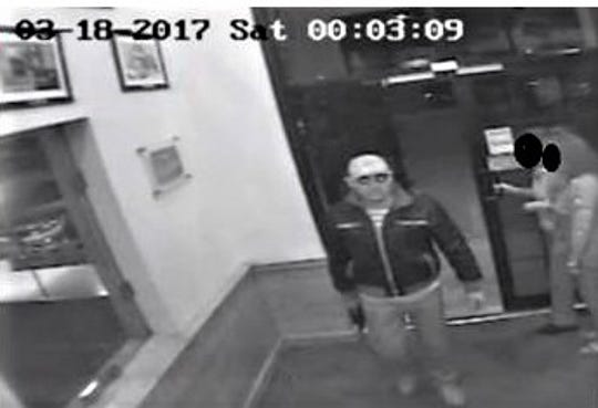 """Prosecutors said a security camera filmed Daniel Ricardo """"El Tips"""" Lucero Escarcega standing watch at the entrance of an Applebee's restaurant in Juarez, Mexico, during a gang hit on March 18, 2017."""
