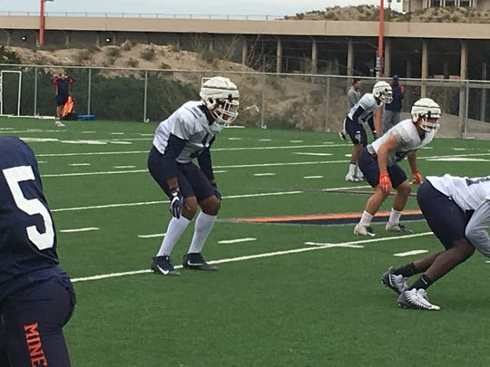 UTEP junior transfer linebacker Joe Jay Smith, left in white, prepares for a snap at Monday's spring practice