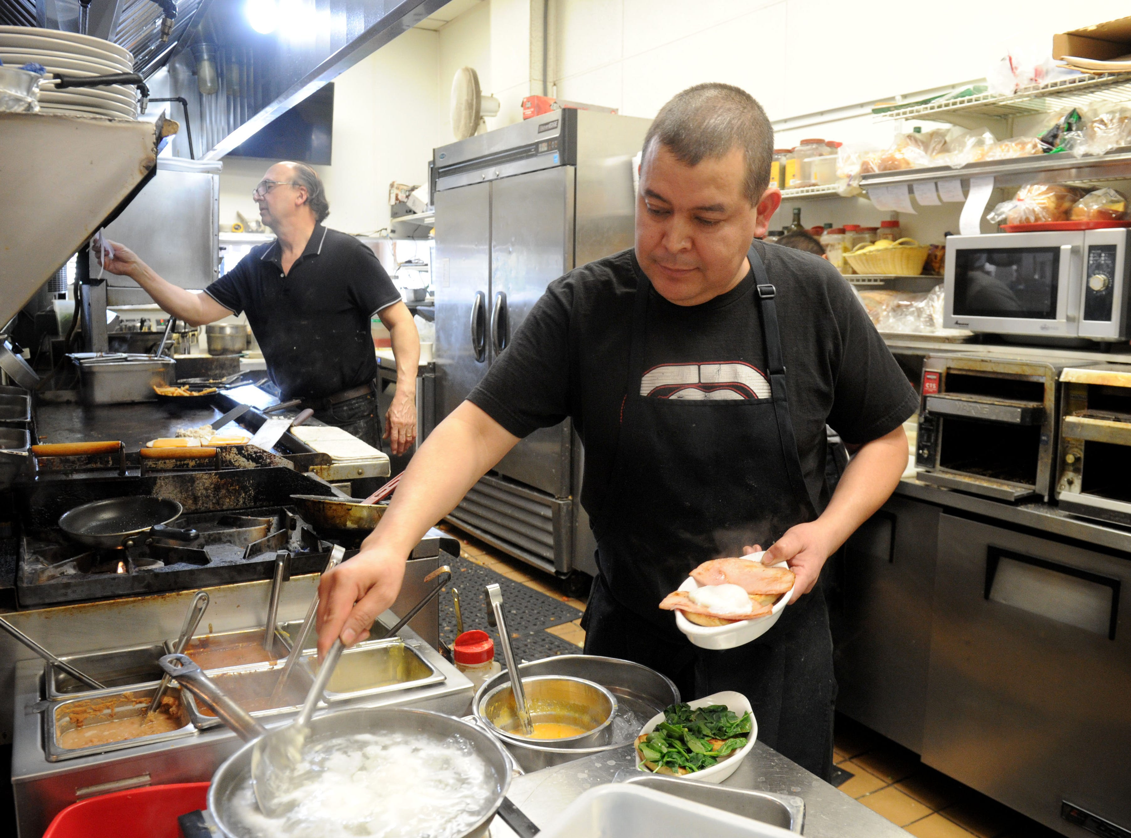 Thomas Fontes, left, owner and chef of Jessica's Cafe and Enrique Martinez  prepare breakfast at the Camarillo restaurant.