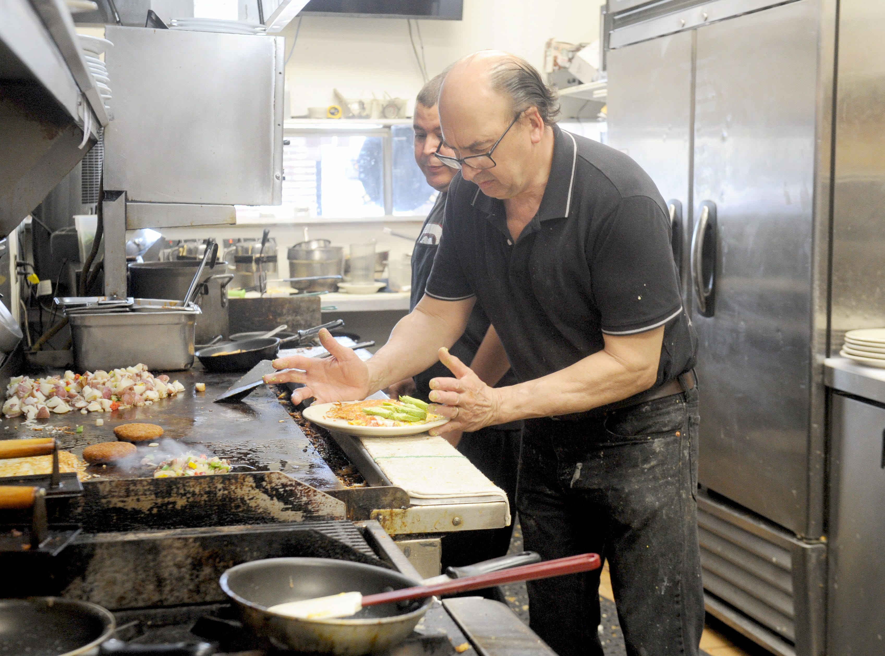 Thomas Fontes, owner and chef of Jessica's Cafe in Camarillo, and Enrique Martinez prepared breakfast meals at the restaurant.