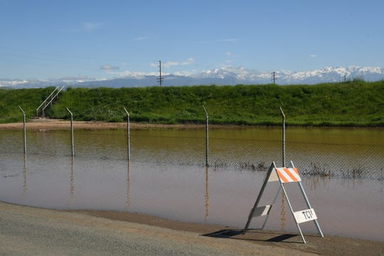 Homes across the street from this storm basin on Road 234 in Strathmore were flooded after it overflowed on Friday.